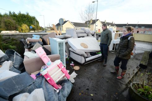 Emmet & Elaine Conroy  look over the water damaged contents of their home near the Manor Road in Mountmellick. Photograph: Alan Betson / The Irish Times