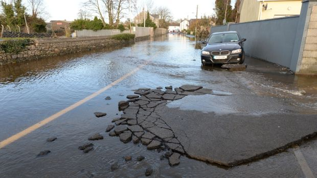 The damaged surface of Manor Road in Mountmellick after local rivers burst their banks on Wednesday. Photograph: Alan Betson/The Irish Times