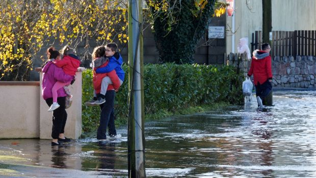 Local residents on Manor Road in Mountmellick, where up to half a metre of water flooded into homes on Wednesday. Photograph: Alan Betson/The Irish Times