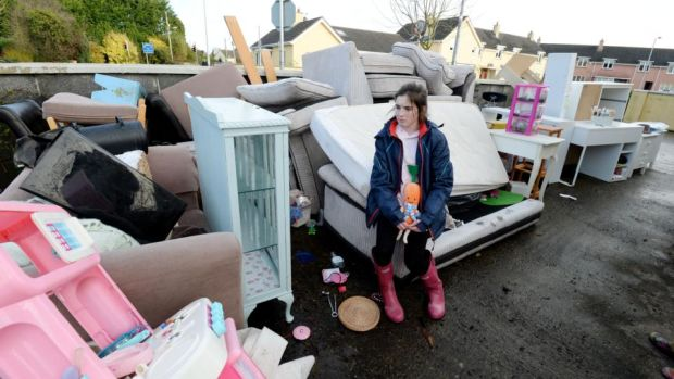 Ita Conroy surveys the water-damaged contents of her home near Manor Road in Mountmellick after it was inundated with floodwater on Wednesday. Photograph: Alan Betson/The Irish Times