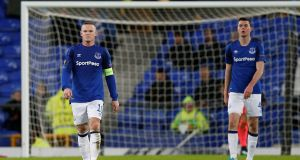 Everton's Wayne Rooney and Michael Keane look dejected at the final whistle of their Europa League clash with Atalanta. Photo: Andrew Yates/Reuters