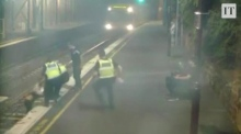 CCTV captures dramatic train track rescue