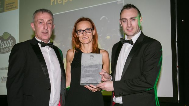 Oonagh Mc Nerney, Co - founder & CEO, Visum presents the Agribusiness of the Year – Prepared Foods award to Robert Devlin and Patrick Meade, Meade Potato Company