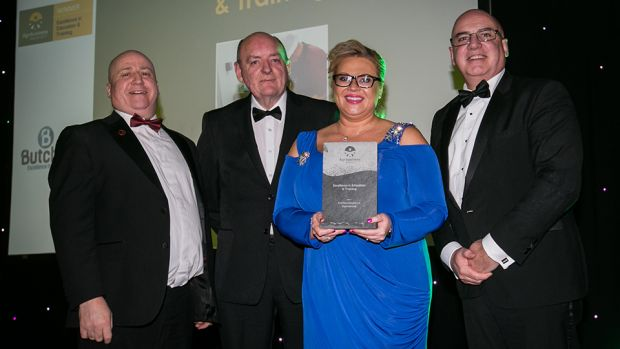 Denis O'Brien, Director of Standards & Solutions, GS1 Ireland, presents the Excellence in Education & Training award to Denis Lang, Sean Owen & Rhonda Montgomery, Butchery Excellence International