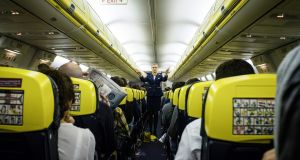 A Ryanair flight attendant gives directions before departure at Dublin Airport Photograph: The New York Times