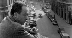 Albert Camus outside his Paris office in 1957. Photograph: Loomis Dean/Time & Life Pictures/Getty Images