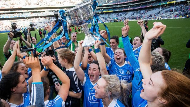 Dublin's Lydsey Davey and her team-mates celebrate with the Brendan Martin Cup after the All-Ireland final win over Mayo at Croke Park. Photograph: Ryan Byrne/Inpho