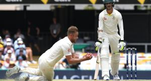 Stuart Broad takes the wicket of Mitchell Starc in Brisbane. Photograph: Dave Hunt/EPA