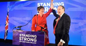 DUP leader Arlene Foster waves to the crowd with deputy leader Nigel Dodds  after her speech in the party's annual conference at the La Mon hotel in Belfast. Photograph: Michael Cooper/PA Wire