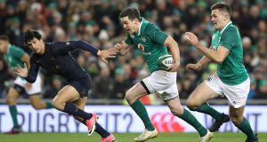 Ireland's Johnny Sexton maks the break that led to Jacob Stockdale's first try. Photograph: Billy Stickland/Inpho
