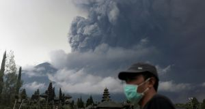 A view from Besakih Temple in Karangasem, Bali,  as Mount Agung erupts. Photograph: Johannes P Christo/Reuters