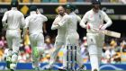 Nathan Lyon celebrates the early dismissal of Mark Stoneman in Brisbane. Photograph: Dave Hunt/EPA