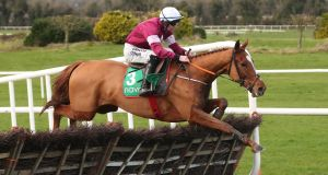 Samcro and Jack Kennedy jump the last at Navan. Photograph: Niall Carson/PA