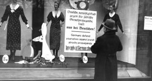 A sign in a shop owned by Jewish people in Berlin, Germany. Photograph: Visual Studies Workshop/Getty Images