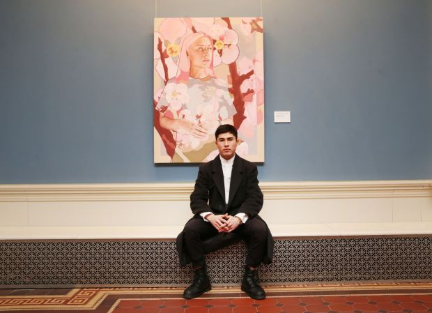 Shane Berkery beside his portrait Lady and the Cherry Blossoms at the National Gallery of Ireland as part of the Hennessy Portrait Prize. Photograph: Leon Farrell/Photocall Ireland.