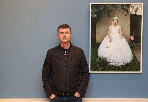 Kenneth O Halloran beside his portrait entitled Winnie Lawrence at the National Gallery of Ireland as part of the Hennessy Portrait Prize. Photograph: Leon Farrell/Photocall Ireland.