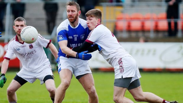 Slaughtnei's Paul McNeill is touch tight on Cavan Gaels' Michael Lyng. Photograph: Jonathan Porter/Inpho