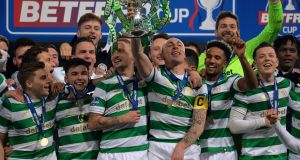 The Celtic squad celebrate winning the Betfred League Cup during the Betfred League Cup final at Hampden Park. Photograph: Mark Runnacles/Getty Images