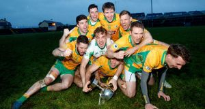 Corofin players celebrate after winning the Connacht final. Photograph: James Crombie/Inpho