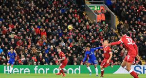 Chelsea's Willian scores his side's first goal during the Premier League match at Anfield. Photograph: Peter Byrne/PA Wire