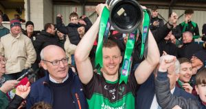 Aidan O'Reilly of Nemo Rangers lifts the trophy at Páirc Uí Rinn after his team defeated All-Ireland club champions Dr Crokes to win the Munster SFC  final.  Photograph: Oisin Keniry/Inpho