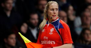 Ireland's Joy Neville in her assistant referee role during France's draw with Japan at the U Arena in Paris on Saturday night.  Photograph: Charles Platiau/Reuters