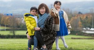 Nancy Lin and her children Kerry (6) and Ethan (3)  in Tymon Park, Tallaght. Photograph:  Dave Meehan