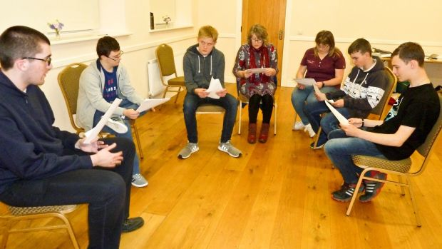 The group reading their lines, along with drama facilitator Maura Williamson