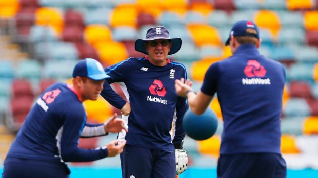 England coach Trevor Bayliss watches Jonny Bairstow warm-up ahead of the final day's play in Brisbane. Photograph: Jason O'Brien/PA