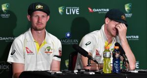 Cameron Bancroft and Australia captain Steve Smith. Photograph: Darren England/EPA
