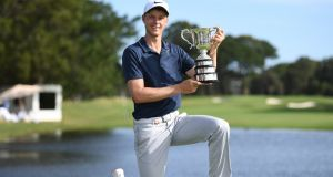 Cameron Davis of Australia poses for photographers while holding The Stonehaven Cup after winning the Australian Open Golf Championship at The Australian Golf Club in Sydney, New South Wales. Photo: David Moir/EPA