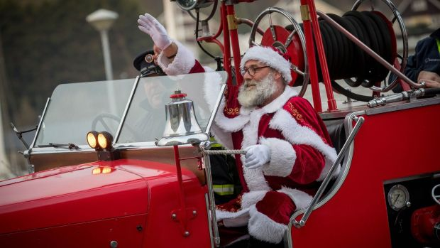 Santa arrives by fire engine for Winterval Festival in Waterford, which runs until December 22nd. Photograph: Dylan Vaughan.