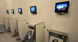 March of progress:  Public toilet in Beijing with wifi, an ATM machine and chargers for mobile phones and electric vehicles. Photograph: AFP/Getty