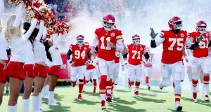 Quarterback Alex Smith (No 11) of  Kansas City Chiefs takes the field with teammates prior to the game against the Buffalo Bills in Kansas City, Missouri. Photograph: Jamie Squire/Getty Images