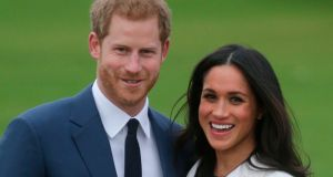 Prince Harry and actor  Meghan Markle pose for a photograph after  announcing their engagement. Photograph: AFP/Getty