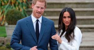 Prince Harry stands with his fiancée actor  Meghan Markle as she shows off her engagement ring  following the announcement of their engagement on Monday. Photograph: AFP/Getty