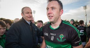 Nemo Rangers star Paul Kerrigan shakes hands with Fianna Fáil leader Micheál Martin TD following the Cork club's side's win over Dr Crokes in the Munster final.  Photograph: Oisín Keniry