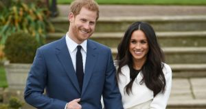 Prince Harry and actress Meghan Markle during an official photocall to announce their engagement in London. Photograph:Eddie Mulholland-WPA Pool/Getty Images 