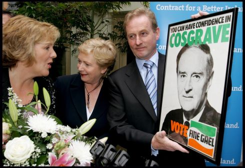 Fine Gael leader Enda Kenny is presented with a Liam Cosgrave poster from the 1973 general election, watched by local candidate Frances Fitzgerald and his wife Fionnuala (left)  in Kennys Pub, Lucan. Photograph: David Sleator