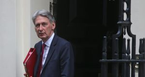 Britain's chancellor of the exchequer Philip Hammond is resigned to higher levels of public debt than were thought conscionable not long ago. Photograph: Daniel Leal-Olivas/AFP/Getty Images