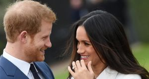 Britain's Prince Harry poses with his fiance Meghan Markle after announcing their engagement  at Kensington Palace in London. Photograph: Facundo Arrizabalaga/EPA