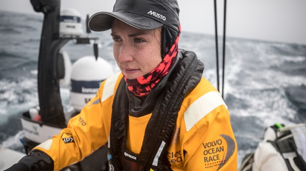 Annalise Murphy steers the boat as it passes Tristan da Cunha in the mid Atlantic. Photo: Sam Greenfield/Volvo Ocean Race