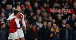 Arsenal's Alexis Sanchez celebrates scoring with Mesut Özil. Photograph: Reuters/Paul Childs