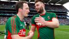 Mayo's Alan Dillon, who has announced his retirement,  and Aidan O'Shea celebrate victory over Roscommon in the All-Ireland quarter-final replay last year.  Photograph: Lorraine O'Sullivan/Inpho