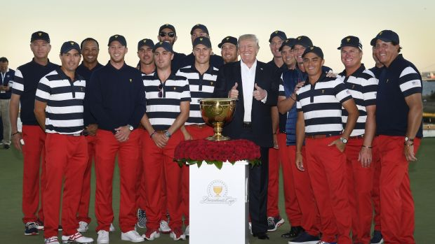Tiger Woods and the rest of the US President's Cup team post with Donald Trump at Liberty National in October. Photo: Getty Images