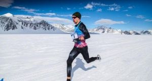 Paul Robinson running the fastest mile on the Antarctic continent. Photograph: Antarctic Ice Marathon