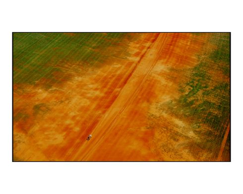 Queensland: An aerial image of a vehicle driving through the outback near the Coomberry Plains area in Queensland, irrigation quickly transforms the scorched red earth to green. Photograph: Bryan O'Brien/The Irish Times