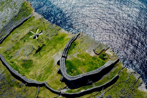 Dun Aengus: The Irish Air Corps in a helicopter at Dun Aengus, the prehistoric fort on the Aran Islands, Co Galway. Photograph: Brenda Fitzsimons/The Irish Times