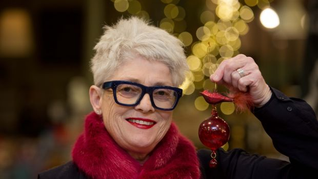"Avoca's Ros Walshe with her favourite decoration, a ""bald"" glass bird. Photograph: Tom Honan."