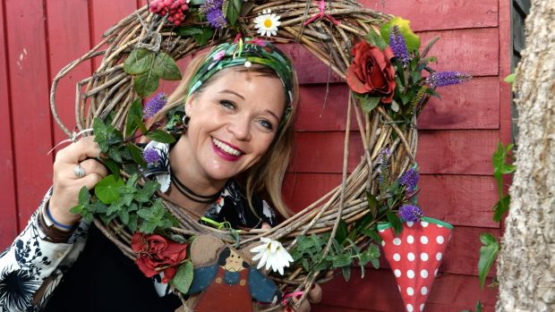 Deborah Donnelly with the Christmas wreath she made. Photograph: Cyril Byrne